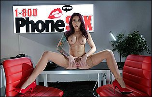 Monique Alexander in sexy stockings and red high heels posing in the office