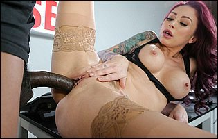 Monique Alexander in sexy nylons and red heels sucking and fucking a big black cock in the office