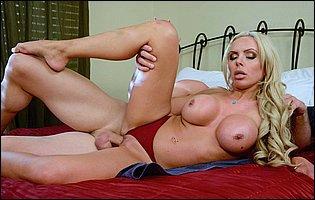Nina Elle spreads legs and fucks a big hard cock
