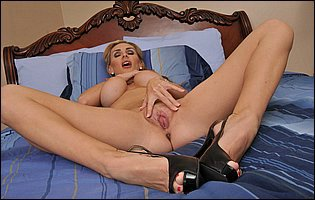 Tanya Tate strips her sexy outfit and underwear and spreading her pussy
