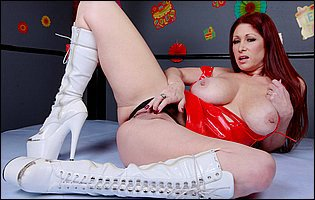 Tiffany Mynx poses in red latex dress and white high boots