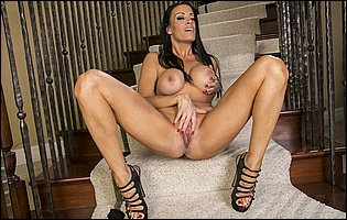 Vanilla Deville in sexy underwear and high heels exposing her body on stairs