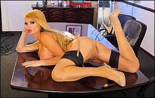 Hot secretary Taylor Wane in sexy nylons and high heels posing in the office