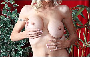 Emma Starr getting nude and sensually touches herself