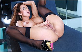 Franceska Jaimes in sexy black lingerie, stockings and high heels teasing with hot body