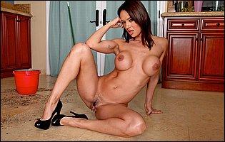 Franceska Jaimes in black underwear and high heels posing in kitchen