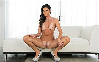India Summer in sexy white underwear and high heels presents tight body