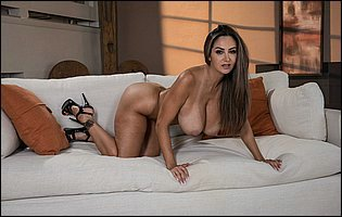 Hot brunette Ava Addams in sexy high heels presents her awesome body