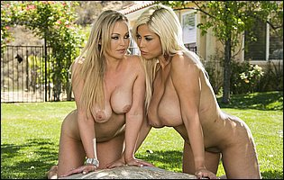 Abbey Brooks and Bridgette B posing naked in the garden