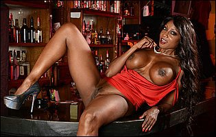 Diamond Jackson strips off her short red dress at the bar
