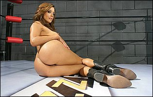 Francesca Le strips her t-shirt, shorts and underwera and poses in black boots in the ring