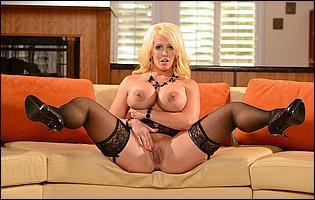 Alura Jenson in black stockings and high heels exposing her body and spreading her legs on sofa